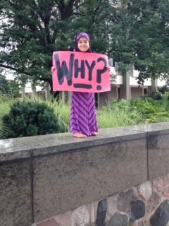 A Palestinian American child protests in Grand Rapids, MI.