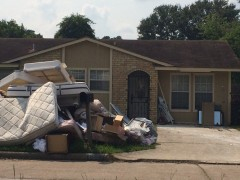 Cleaning up after Hurricane Harvey in  Houston, TX.