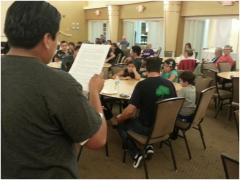 Didier Ortiz of POWIR reads a testimonial