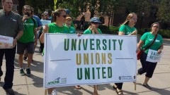 U of M workers marching for raises and respect.