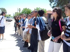 Middle school students forming part of the chain around the TUSD offices.