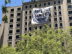 Banner drop in San Diego demanding release and reunification of families