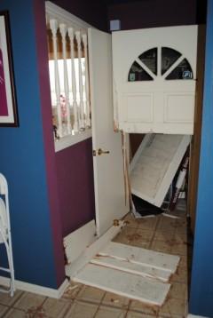 Door kicked down by SWAT team at Carlos Montes' home.