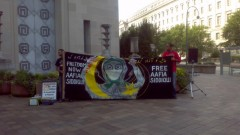 Activists hold banner in defense of Dr. Aafia Siddiqui
