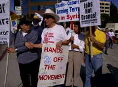 Carlos Montes at LA protest against U.S. intervention in Syria, Iran.