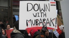 Protest sign reads 'Down with Mubarak!'