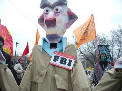 Puppet of FBI agent at May Day Minneapolis May Day parade