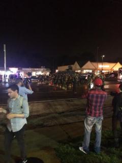 Riot police line up against demonstration in Ferguson, MO.