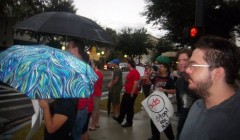 Community members rally outside the office of an FBI agent in downtown Gainesvil
