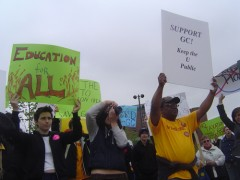 A photo of students protesting and holding signs.