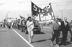 Leola Seals, Reverend Herron, and Jim Anderson lead protest