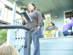 Jenny Eiserts speaking from the steps of Rosemary Williams' home