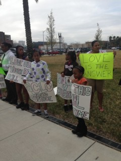 Protesters stand outside the trial demanding Justice for Jordan Davis.