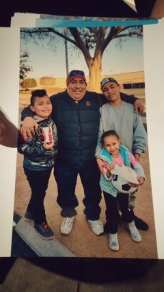 Jose Mendez (right) with family members