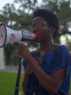 Regina Joseph speaking at June 19 rally