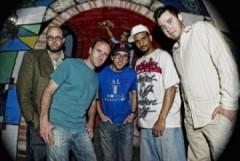 A photo of Junkyard Empire band members.