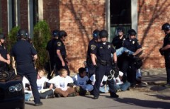 Sit-in line with riot cops