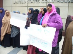 Somali women at Minneapolis protest holding sign