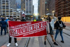Minneapolis protest demands legalization for all.