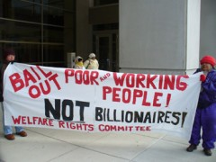 """Banner: """"Bail out poor and working people, not billionaires"""" & it's very cold"""