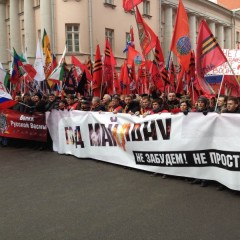 """Massive march in Moscow. Front banner reads, """"One Year Since Maidan: We Won't Fo"""