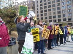 Tracy Molm, leading chants at protest against war on Libya