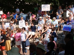 A photo of a hundred people holding healthcare reform signs