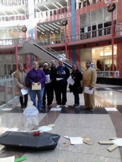 Community advocates deliver a petition with 1000 signatures to the office of Gov