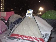 Snow falls on Nov. 29 Occupy Minneapolis encampment.