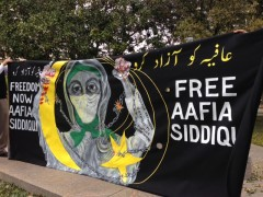 Banner at March 29 protest to demand freedom for Dr. Siddiqui.