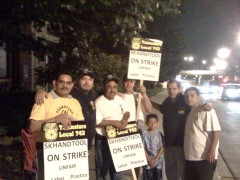 Picketers with Teamsters 743 standing and holding signs outside SK Hand Tools