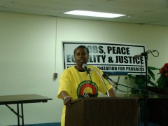 Cynthia McKinney speaking at a meeting of the People's Organization for Progress
