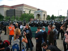 Protesters stopped by line of riot police.