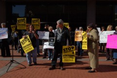 """Press conference at courthouse. Signs say """"Stop foreclosures and evictions"""""""