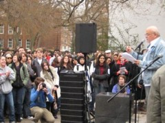 Larry Romsted speaks to a crowd of students
