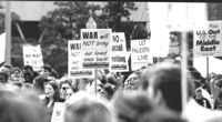 Crowd with signs at D.C anti-war march.