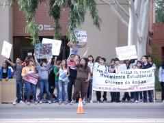 MEChA students protesting outside a school