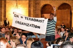 Students disrupt speech by ex-CIA Director Brennan.