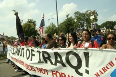 protesters carrying banner that says: US OUT OF IRAQ!