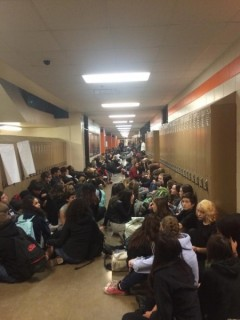 Huge sit in at South High School demands justice for Mike Brown.