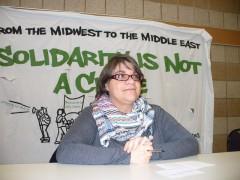 Photo of Jess Sundin speaking in Minneapolis.