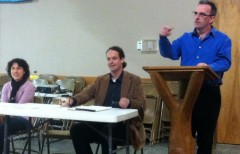 Tom Burke (right) speaking at the National Lawyers Guild (NLG) conference