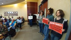 Protest at Met Council meeting demands end to immigration enforcement on public
