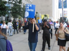 Mark Clements leads chants against the scheduled execution of Troy Davis.