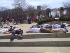 """A photograph of students """"die-ing in"""" on University of Alabama's campus."""