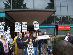 Quad City Die Casting workers rally at a Wells Fargo branch.
