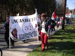 Marching with SDS banner