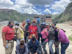 Venezuelan women construct new housing with government assistance.