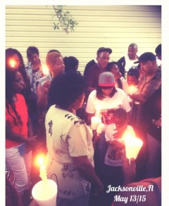 Family and supporters of D'angelo Stallworth gather for a candlelight vigil