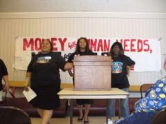 Three women at podium